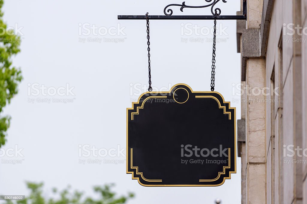 shop sign hanging on the wall stock photo