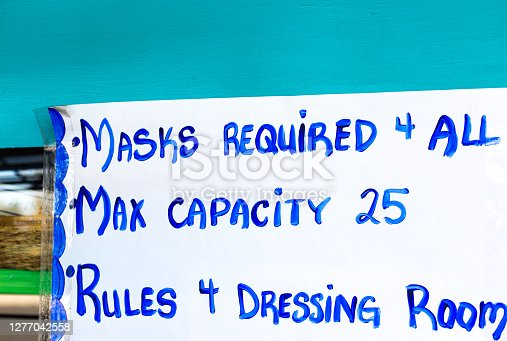 istock Shop Sign with Pandemic Rules: Masks Required 4 All 1277042558