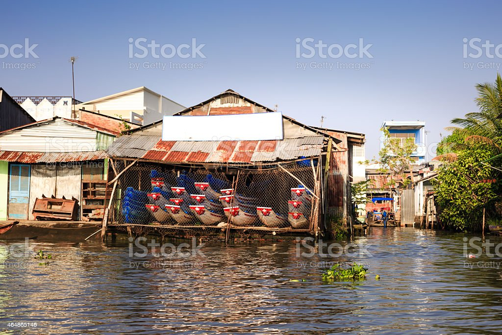 Shop small boats on the river stock photo