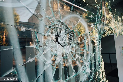 Shop window broken by riots in Chile