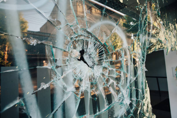 Shop window broken Shop window broken by riots in Chile crime stock pictures, royalty-free photos & images