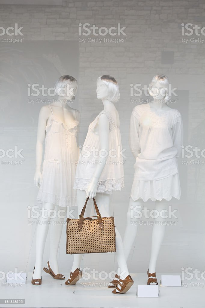 Shop window mannequins in pretty clothing stock photo