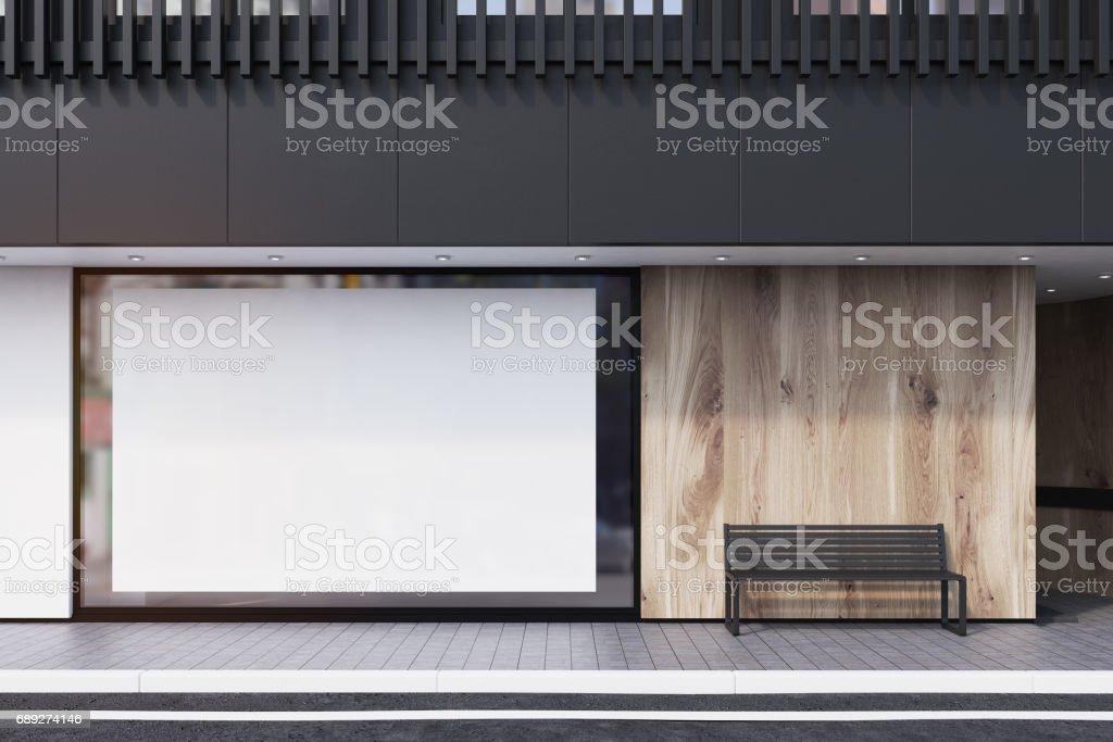Shop window, poster, bench, black stock photo