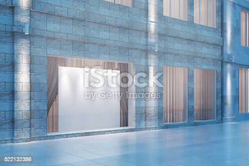 istock Shop window with a white empty billboard at evening 522132386