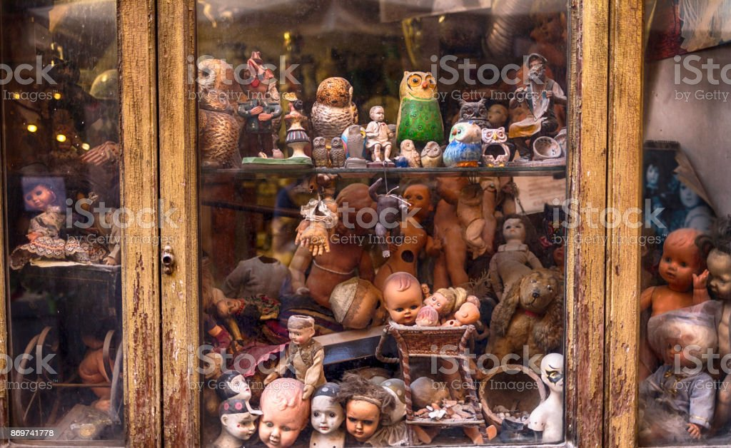 Shop window with old toys stock photo