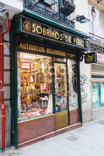 Madrid, Spain - March 17, 2015: shop with devotional objects in the center of Madrid. Madrid is the capital and largest city of Spain and the third largest city on the European Union.