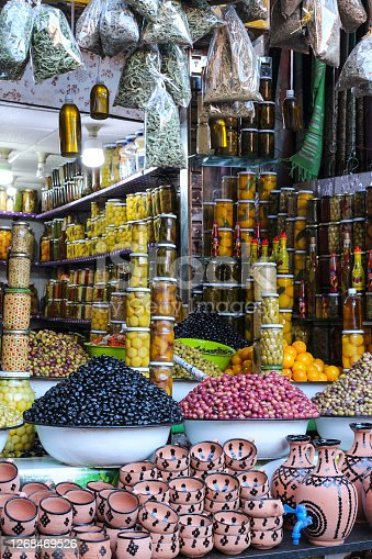 Shop with olives in the main market of Marrakech. Olives in basins, mountains of olives, olives in jars. The main Souk market in Marrakech. Morocco.