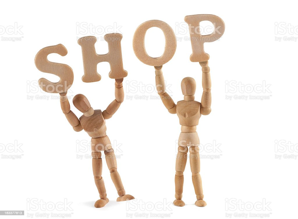 Shop - wooden mannequin holding this word stock photo