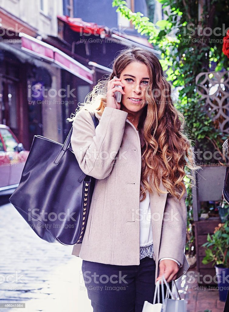 Shopacolic Girl talking on the smartphone stock photo
