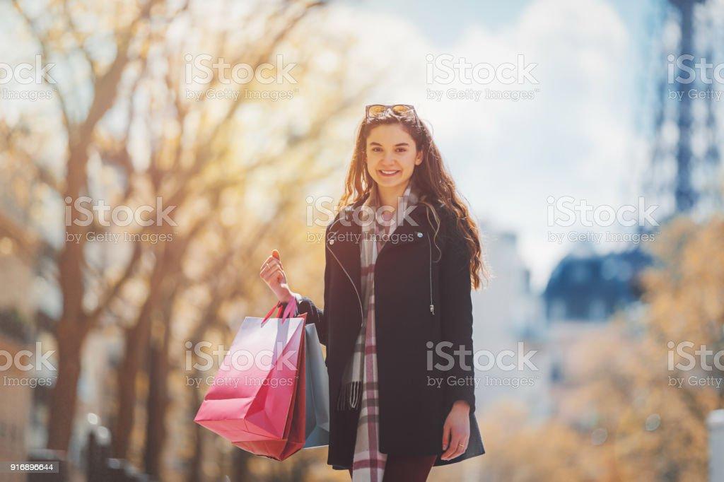 Shopacolic young woman walking with shopping bags in Paris stock photo