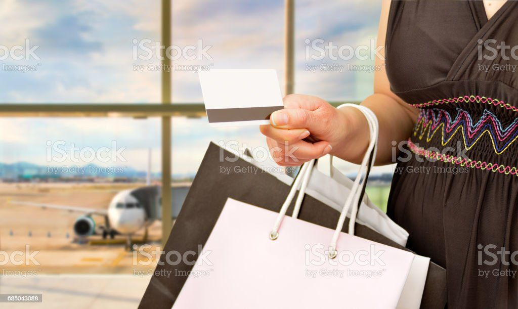 shopaholic with credit card stock photo