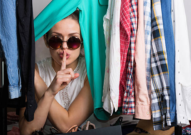 Shopaholic woman and her wardrobe stock photo