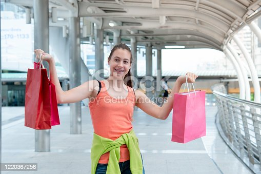 Shopaholic Women holding shopping bags ,money ,credit card person at shopping malls.Fashionable Woman love online website with sales tag on black Friday. E-commerce fashion digital marketing lifestyle