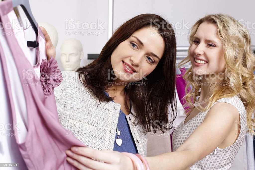 Shopaholics in clothing department royalty-free stock photo