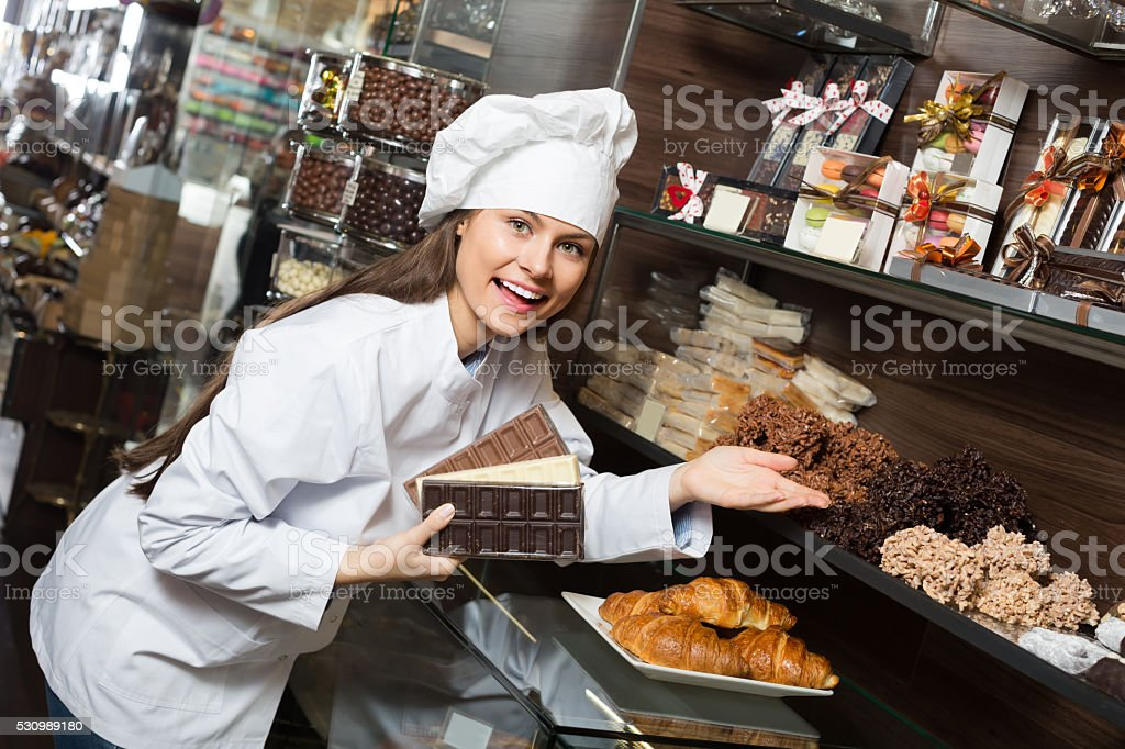 Shopgirl with chocolate and confectionery stock photo