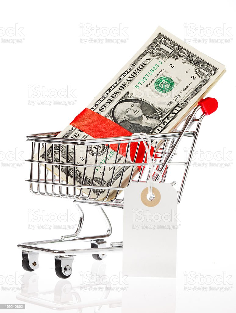 Shoping cart with money stock photo