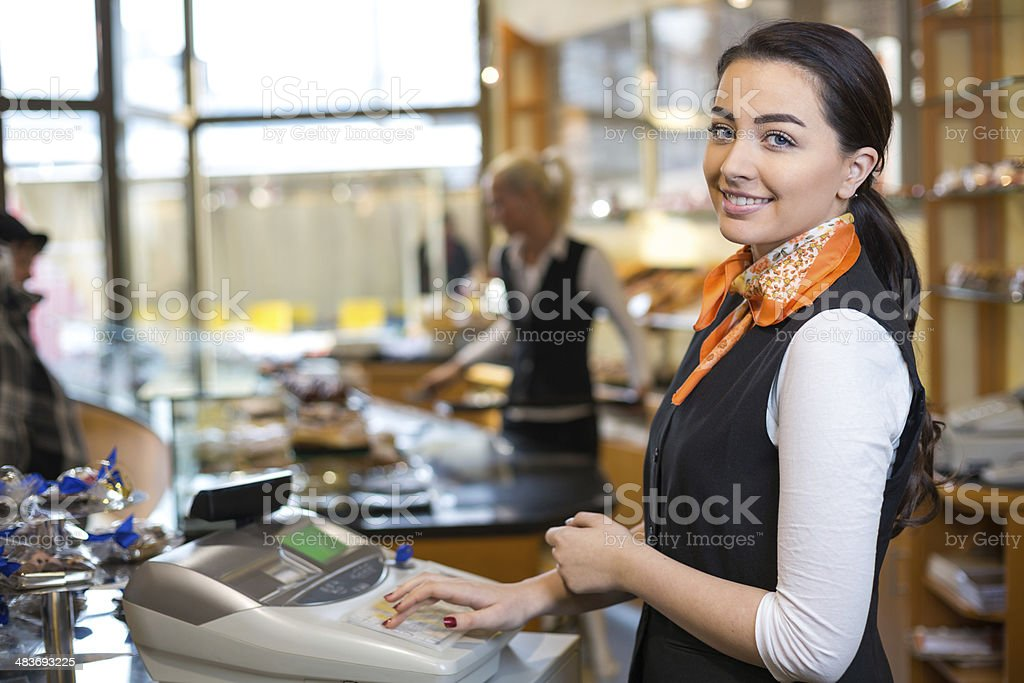 Shopkeeper and saleswoman at cash register stock photo
