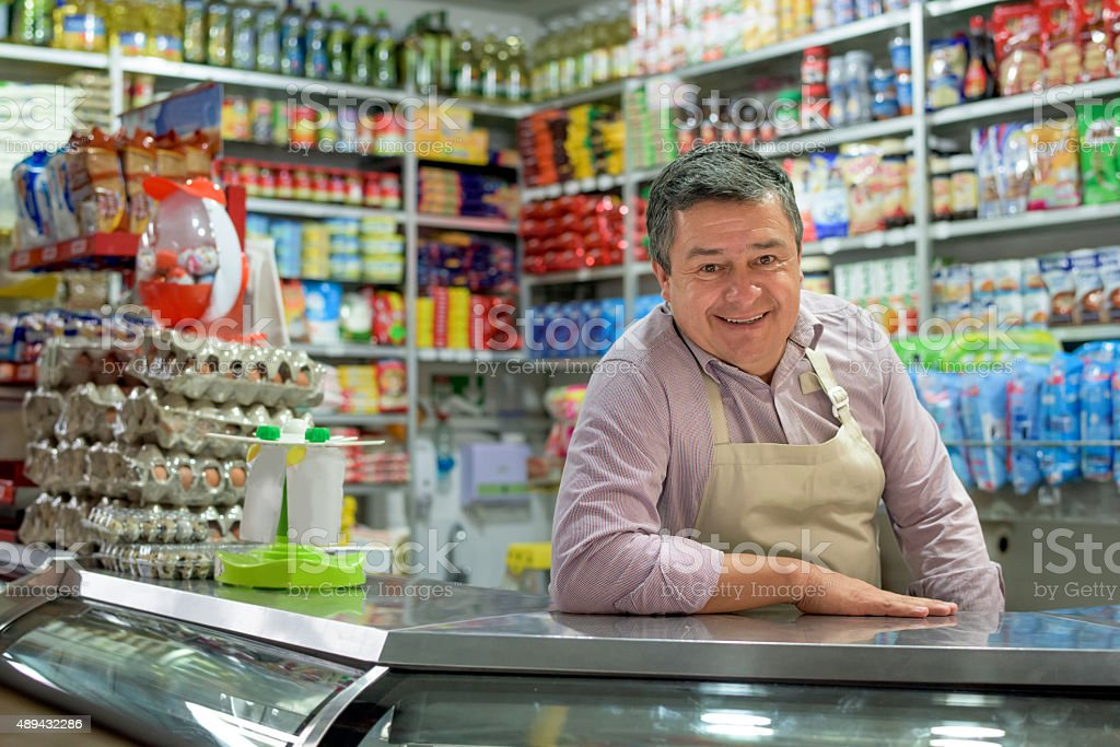 Shopkeeper at a local food shop stock photo