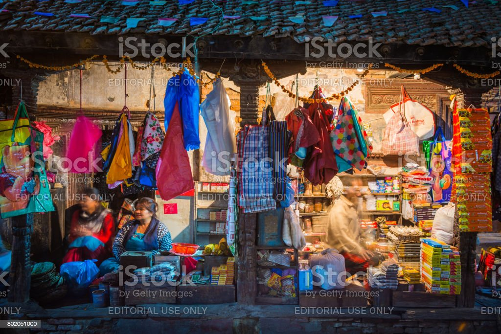 Shopkeepers at colourful roadside stall at night Kathmandu Nepal stock photo