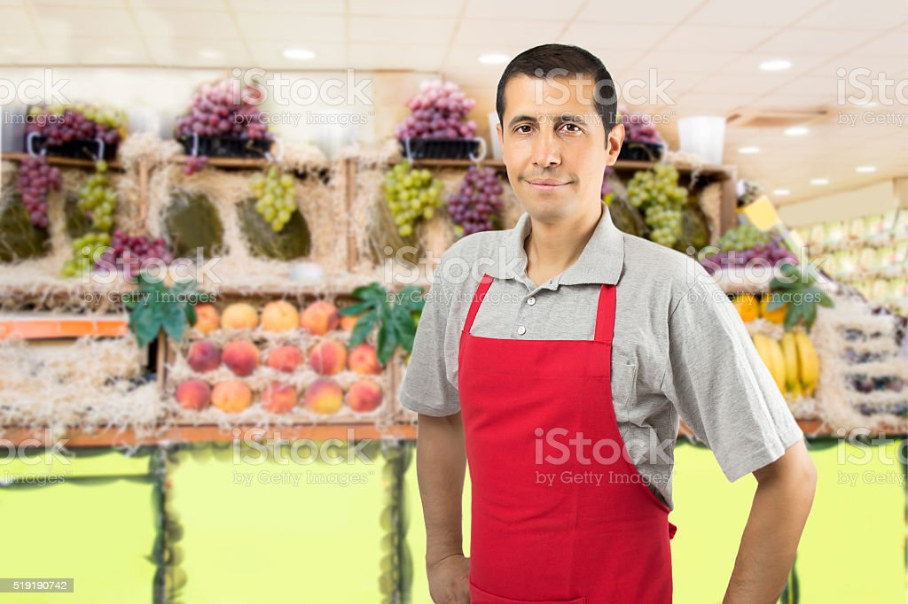 shopman at the fruitshop stock photo