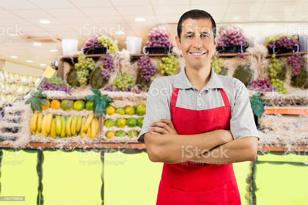 shopman at the greengrocer stock photo