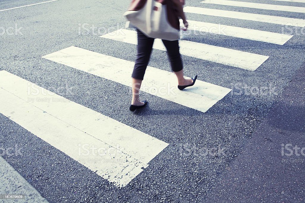 Shopper at zebra crossing royalty-free stock photo