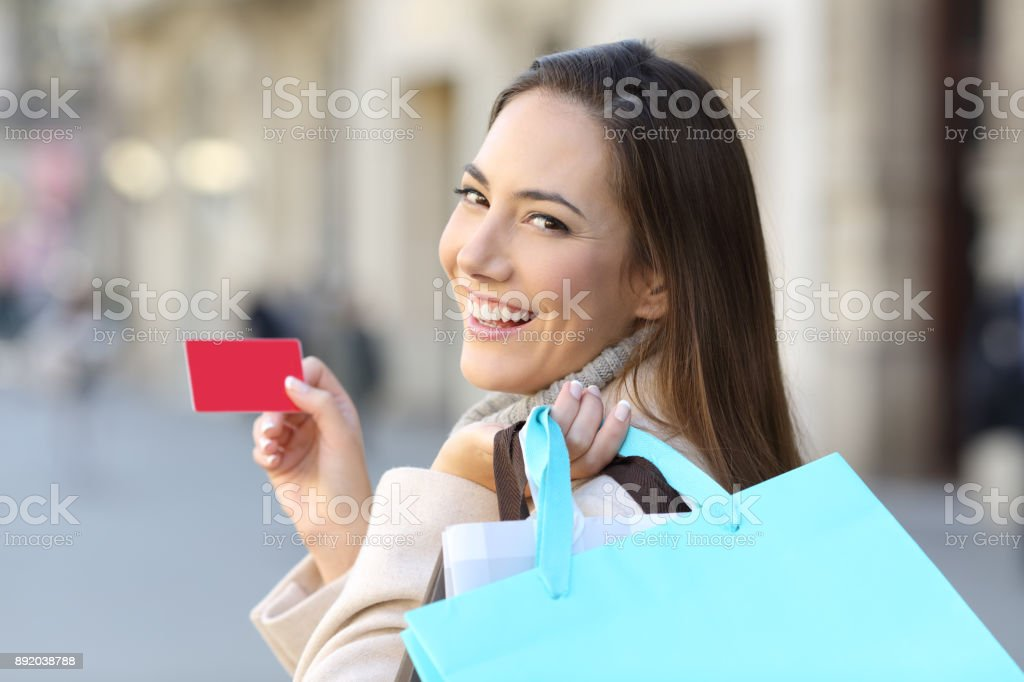 Shopper holding shopping bags and credit card stock photo