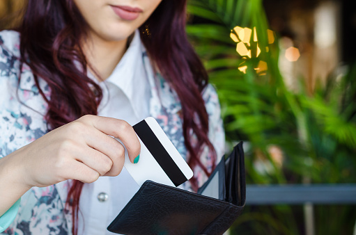 istock Shopper takes the credit card out of wallet. 635806912