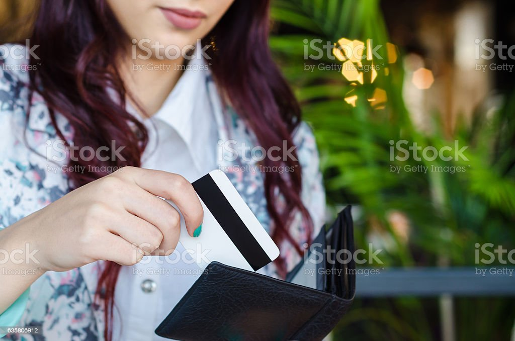 Shopper takes the credit card out of wallet. stock photo