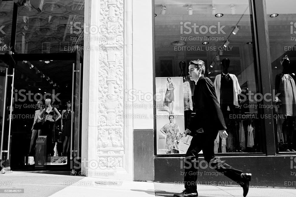 Shopper walking along a sidewalk stock photo