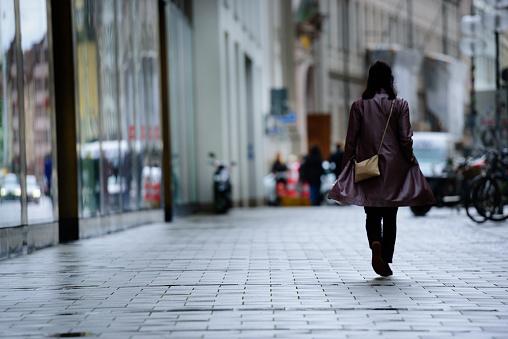 Shopper walking in rain
