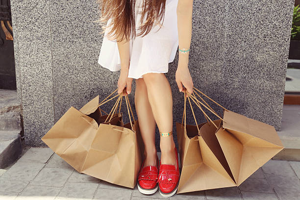 shopper woman - spending money stock pictures, royalty-free photos & images