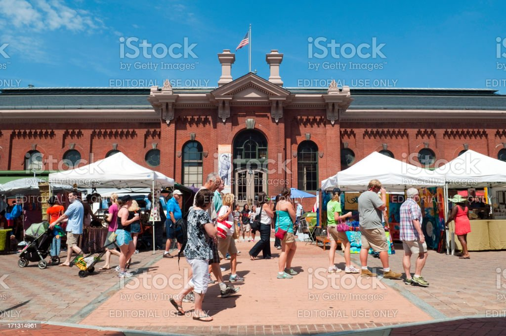Eastern Market in Washington DC Washington DC, USA - June 16, 2012: Shoppers and other visitors take a Saturday stroll though Eastern Market on Capitol Hill. Eastern Market is the oldest continually operated fresh food public market in Washington DC. Art and craft products are also sold here. Built Structure Stock Photo