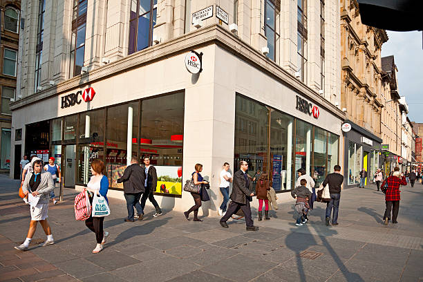 Shoppers and pedestrians, central Glasgow, HSBC branch Glasgow, Scotland, UK - 19th April, 2011: Shoppers and pedestrians walking at the junction between Argyle Street and Buchanan Street, two of the main shopping streets in central Glasgow. An HSBC bank is the most prominent building in the background. hsbc stock pictures, royalty-free photos & images