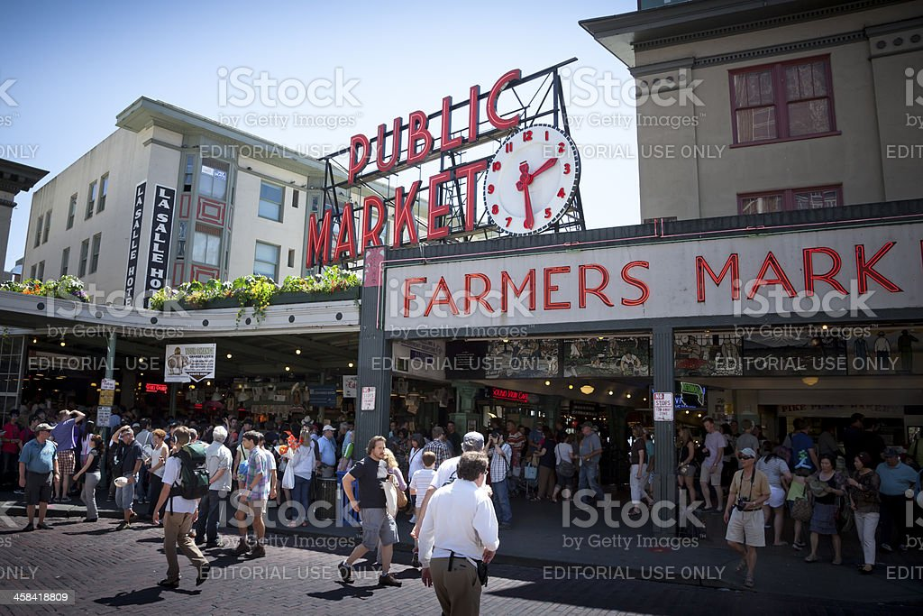 Shoppers and tourists visit Pike Place Market in Seattle, Washington. stock photo