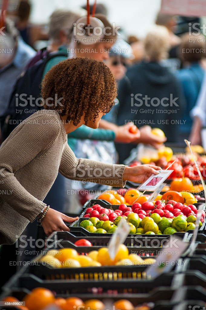 Shoppers explore a local farmers market in Vancouver. stock photo