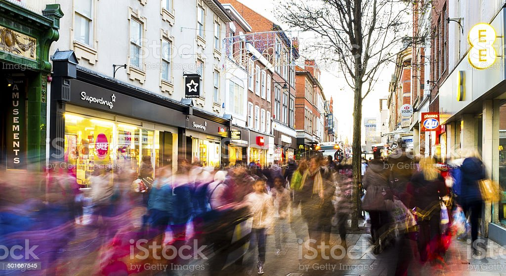 Shoppers hurry past in post-Christmas sales frenzy 2013. stock photo