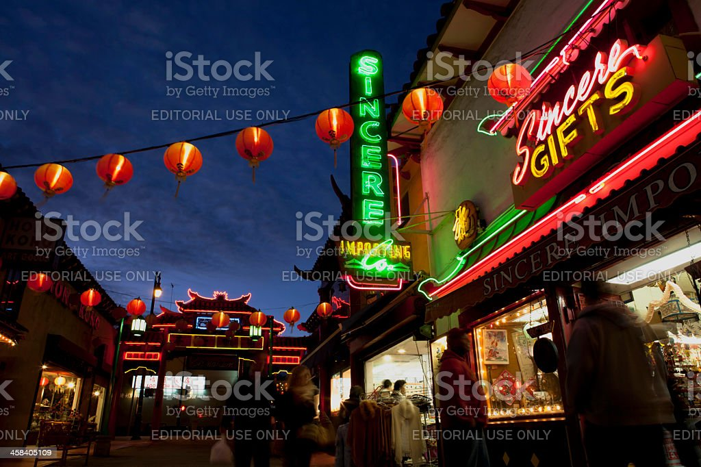 Shoppers in Chinatown, Los Angeles at night stock photo