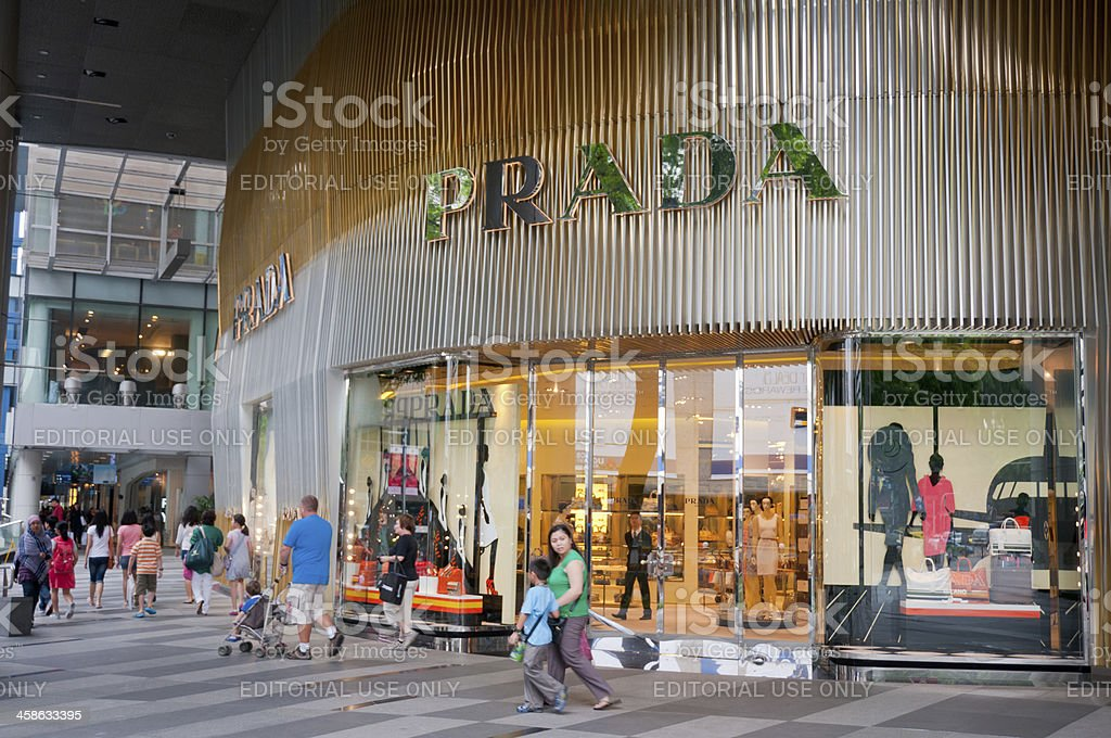 Shoppers In Singapore's Orchard Road Walk Past A Prada Shop stock photo