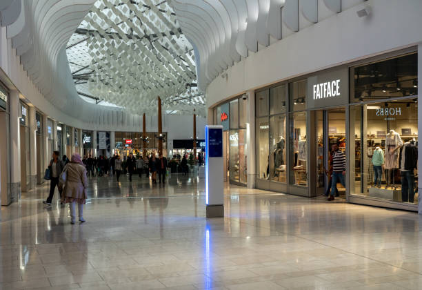Shoppers inside the mall area of the O2 Arena in North Greenwich stock photo