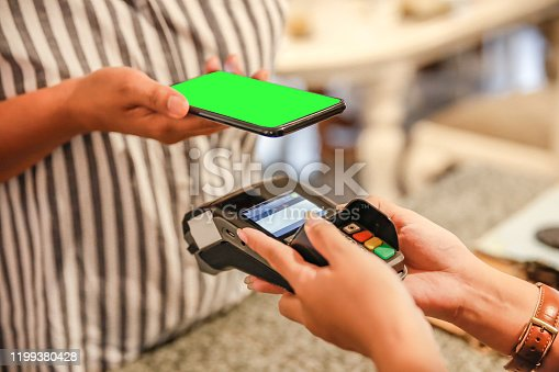 Close up Asian customer paying food and drinks with mobile payment app