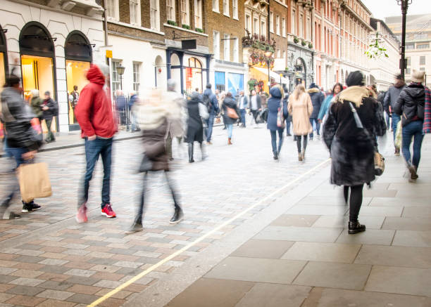 shoppers on busy london high street - people uk stock photos and pictures
