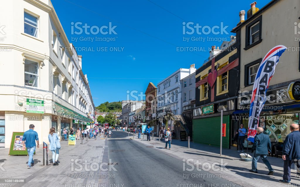 Shoppers on Fleet Street in Torquay, Devon stock photo