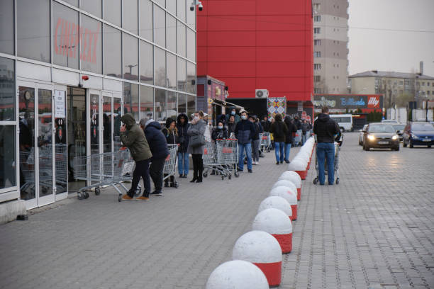 Shoppers stand in a queue outside a supermarket after a coronavirus picture id1214537985?b=1&k=6&m=1214537985&s=612x612&w=0&h=gtenwaunmcicbm ofidits53honbmths n fn8i07dk=