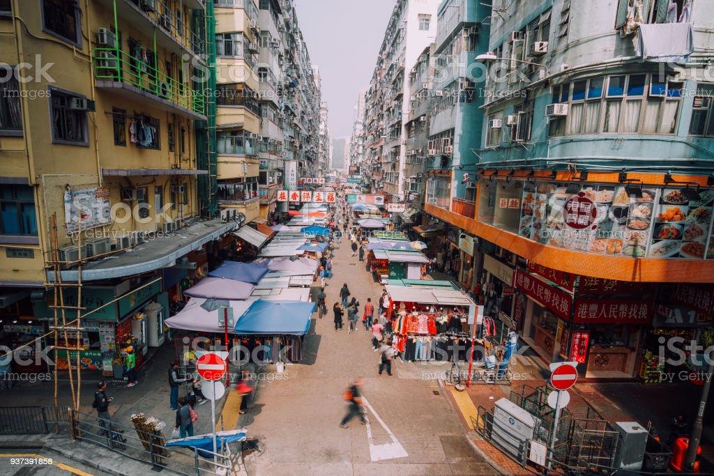 Shoppers stroll along Mong Kok market, Hongkong Street market, Fa Yuen Street, Mong Kok, Kowloon, Hong Kong. Adult Stock Photo