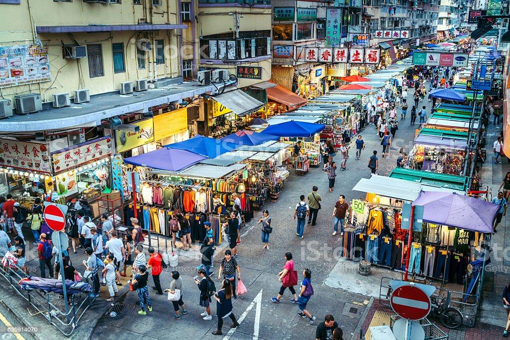 Shoppers stroll along Mong Kok market stock photo