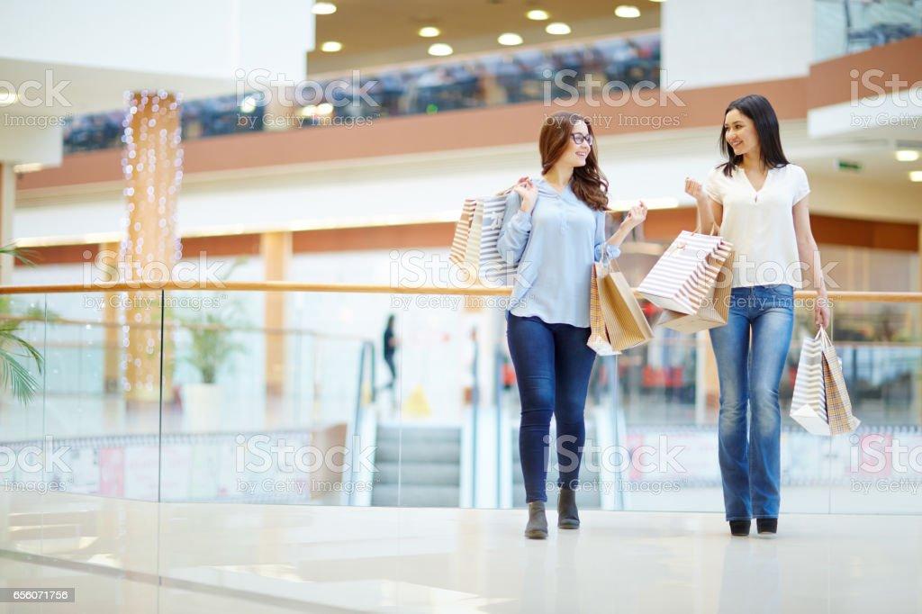 Shoppers talking stock photo