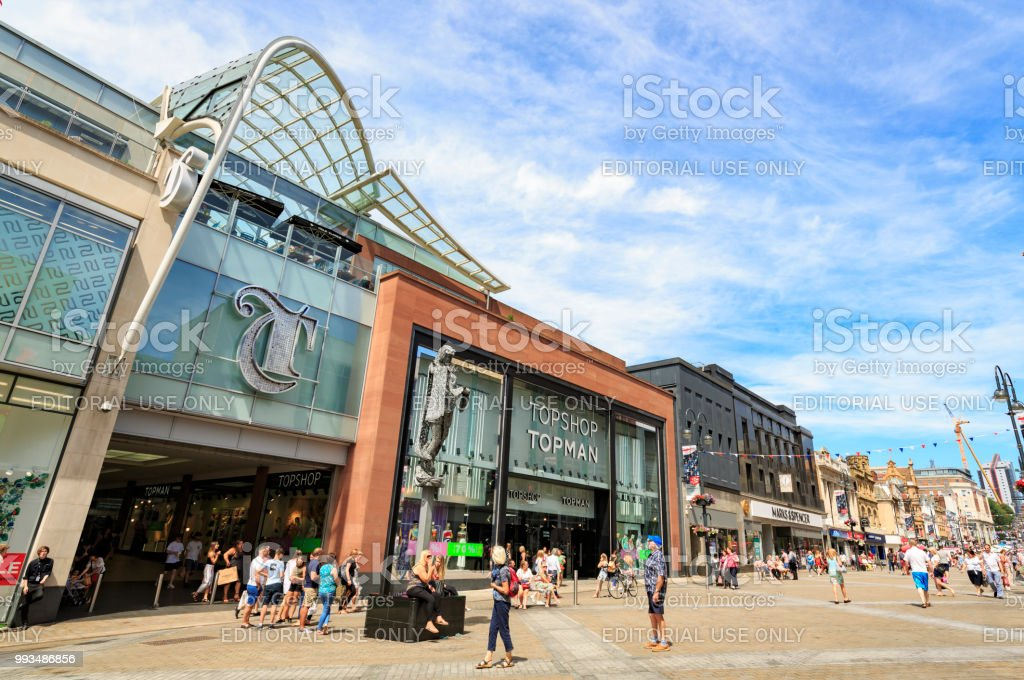 Shoppers walking by the Trinity shopping centre in Leeds stock photo
