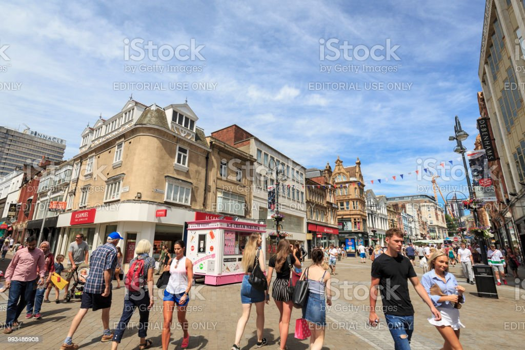 Shoppers walking in a pedestrianised area of Leeds stock photo