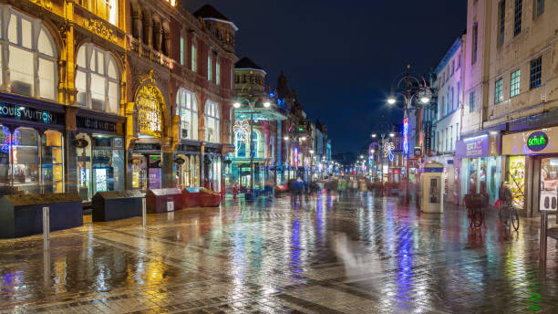 Shoppers walking through the centre of Leeds at night stock photo